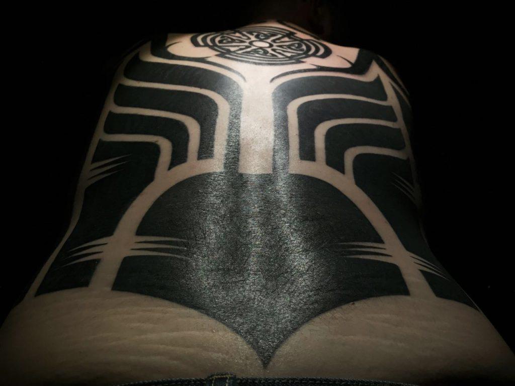Hanumantra bold minimal blackwork backpiece tattoo birmingham shrewsbury un1ty style4