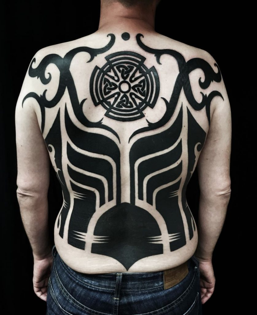 Hanumantra bold minimal blackwork backpiece tattoo birmingham shrewsbury un1ty style6