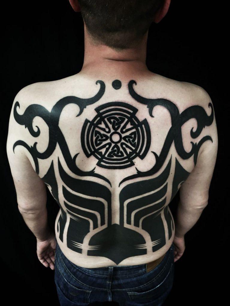 Hanumantra bold minimal blackwork backpiece tattoo birmingham shrewsbury un1ty style7