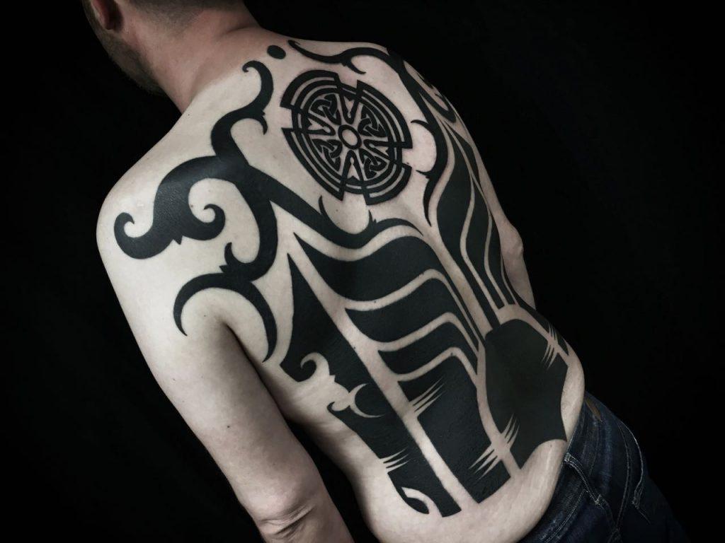 Hanumantra bold minimal blackwork backpiece tattoo birmingham shrewsbury un1ty style8