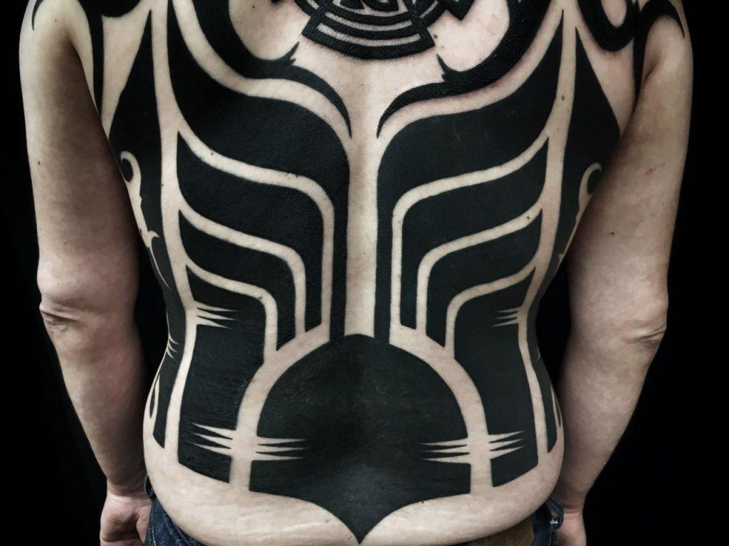 Hanumantra bold minimal blackwork backpiece tattoo birmingham shrewsbury un1ty style9