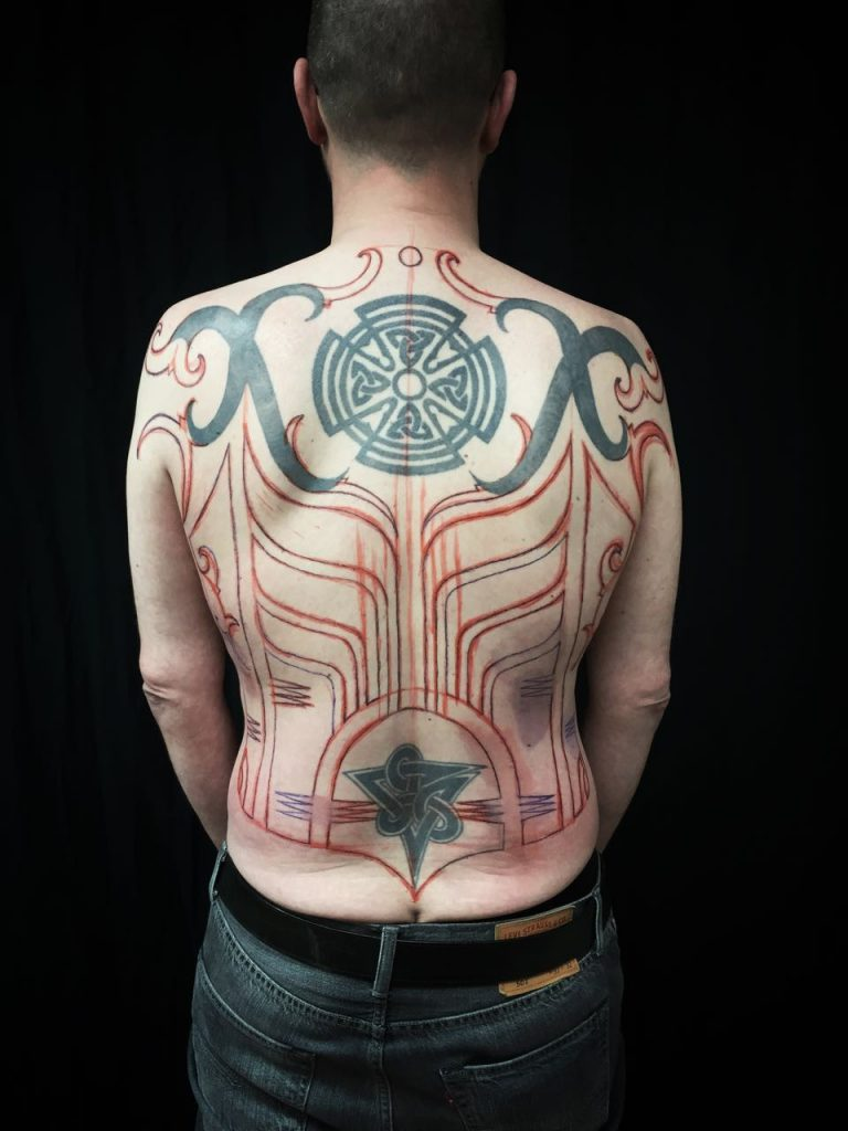 Hanumantra bold minimal blackwork backpiece tattoo birmingham shrewsbury un1ty4