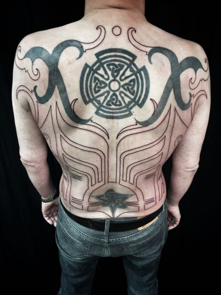 Hanumantra bold minimal blackwork backpiece tattoo birmingham shrewsbury un1ty6